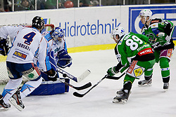 David Sefic (HDD Tilia Olimpija, #89) vs Adam Munro (SAPA Fehervar AV19, #51) during ice-hockey match between HDD Tilia Olimpija and SAPA Fehervar AV19 at second match in Quarterfinal  of EBEL league, on Februar 21, 2012 at Hala Tivoli, Ljubljana, Slovenia. HDD Tilia Olimpija won 2:1 in OT. (Photo By Matic Klansek Velej / Sportida)