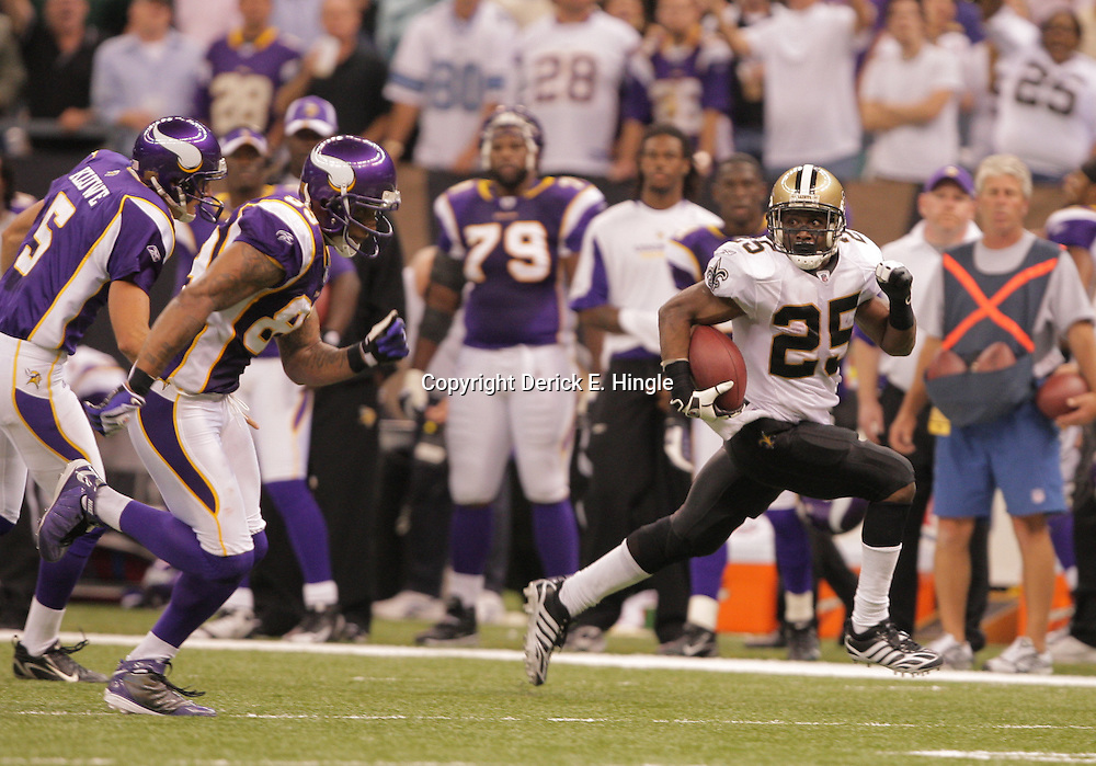 2008 October, 06: New Orleans Saints running back Reggie Bush (25) returns a punt 64-yards for a touchdown in the fourth quarter of a week five regular season game between the Minnesota Vikings and the New Orleans Saints for Monday Night Football at the Louisiana Superdome in New Orleans, LA.