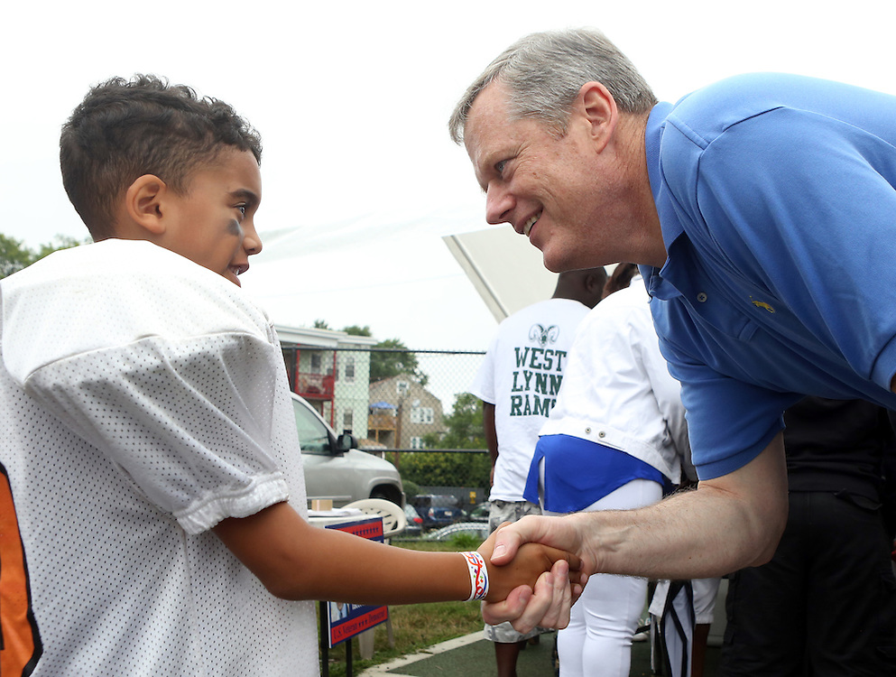 (Boston, MA -- 8/23/15)  Gov. Charlie Baker talks with Randel Diaz, 8, of the Boston Bengals during the Boston Mayor's Cup at Roberts Playground in Dorchester, Sunday, August 23, 2015. Staff photo by Angela Rowlings