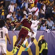 Uruguay Midfielder EGIDIO AREVALO RIOS (17) and Venezuela Attacker SALOMON RONDON (9) dives for the ball in the second half of a Copa America Centenario Group C match between Uruguay and Venezuela Thursday, June. 09, 2016 at Lincoln Financial Field in Philadelphia, PA.