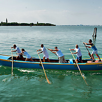 "VENICE, ITALY - SEPTEMBER 04:  Members of the Voga Veneta Lido rowing club practice on a ""Caorlina"" a traditional Venetian boat ahead of Sunday Historic Regata on September 4, 2010 in Venice, Italy. The Historic Regata is the most exciting rowing race on the Gran Canal for the locals and one of the most spectacular ***Agreed Fee's Apply To All Image Use***.Marco Secchi /Xianpix. tel +44 (0) 207 1939846. e-mail ms@msecchi.com .www.marcosecchi.com"