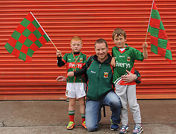 Shane and Oran Tomas with dad Niall Tomas from Killala at the All Ireland Semi Final against Kerry at Croke Park.<br />Pic Conor McKeown