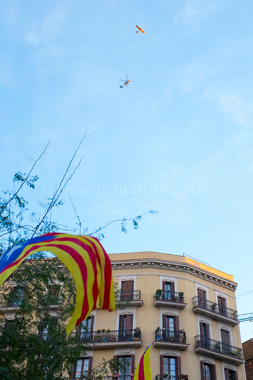 A private plane, a police helicopter and a the estelada flag. More than 750,000 people crowd onto Carrer de La Marina, Barcelona, to protest the jailing of Catalan government ministers and civil society leaders on Saturday November 11, 2017.