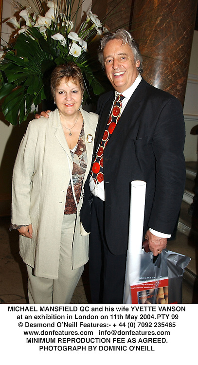 MICHAEL MANSFIELD QC and his wife YVETTE VANSON at an exhibition in London on 11th May 2004.PTY 99