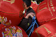 Preparations in London's Chinatown for the mid-Autumn (also Lantern or Moon) Festival where paper lanterns are to hang. The Mid-Autumn Festival, also known as the Moon Festival or Zhongqiu Festival is a popular harvest festival celebrated by Chinese, Korean, and Vietnamese people, dating back over 3,000 years to moon worship in China's Shang Dynasty.