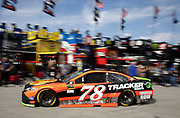 Martin Truex Jr. (78) heads back to the garage during practice for the NASCAR Monster Cup auto race at Kansas Speedway in Kansas City, Kan., Friday, Oct 20, 2017. (AP Photo/Colin E. Braley)
