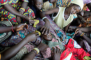 One year old David Arambi died at the local hospital after being sick for five days with Malaria.This was the second child his mother (right ) lost to malaria while living in a IDP camp in the village of Zemio. The family fleed after their village ( some km. from Zemio ) was attacked by LRA. The central African rep. has some of the world's worst child welfare indicators. The infant mortality rate is 112, and out of 1,000 children born in CAR, 171 will die before reaching the age of five. The five main child killers in CAR are malaria, diarrhoea, acute respiratory infections, malnutrition and measles – all preventable diseases. The Accelerated Child Survival and Development Strategy UNICEF is implementing aims to reach every newborn and child in every district with a set of priority interventions. Evidence shows that there are a number of known and affordable interventions that if implemented fully could prevent 63 per cent of current childhood mortality.
