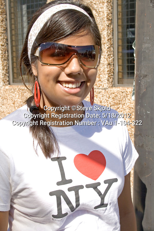 Happy Hispanic Latino female teen teenager smiling at the parade. Mexican Independence Day Minneapolis Minnesota MN USA