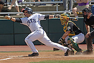 Kansas State's Brandon Farr singles up the middle in the fifth inning, off Baylor Starter Cory VanAllen.  K-State defeated the Baylor Bears 3-1 at Tointon Stadium in Manhattan, Kansas, May 20, 2006.