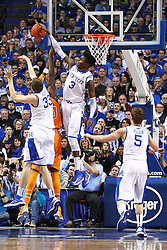 UK forward Nerlens Noel, right, blocks a shot by Tennessee center Yemi Makanjuola in the second half. The University of Kentucky Men's Basketball team hosted University of Tennessee , Tuesday, Jan. 15, 2013 at Rupp Arena in Lexington . Photo by Jonathan Palmer/Special to the Courier-Journal