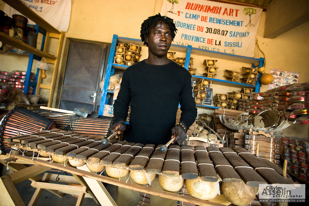 A man plays the xylophone, or balafon, at the Village Artisanal de Ouagadougou, a cooperative that employs dozens of artisans who work in different mediums, in Ouagadougou, Burkina Faso, on Monday November 3, 2008.