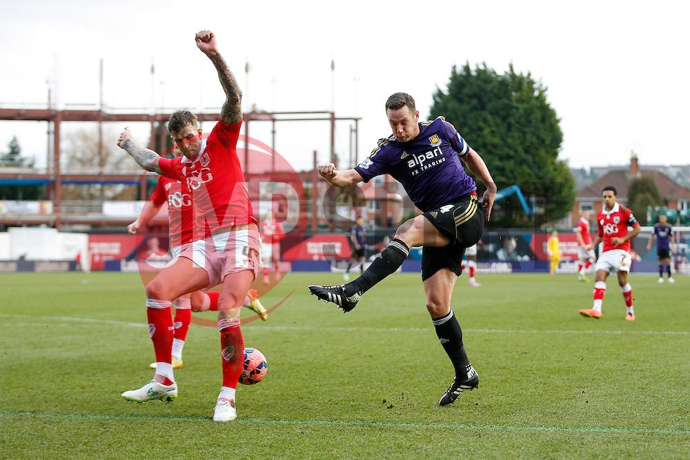 Aden Flint of Bristol City blocks a shot from Kevin Nolan of West Ham - Photo mandatory by-line: Rogan Thomson/JMP - 07966 386802 - 25/01/2015 - SPORT - FOOTBALL - Bristol, England - Ashton Gate Stadium - Bristol City v West Ham United - FA Cup Fourth Round Proper.