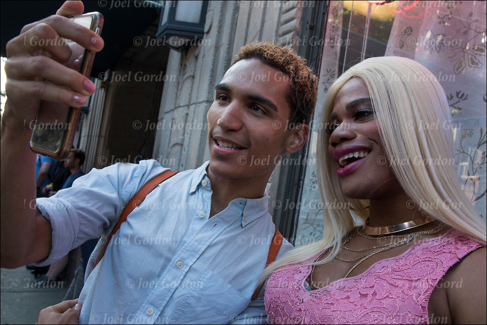 Justin Sams and friend taking selfie.<br /> <br /> Justin Sams is an actor and writer, he is best known for Pink (2017) Last Men (2016) First Dates (2015) and Deadman's Barstool.<br /> <br /> Raise the Rainbow!  Gilbert Baker Memorial Rally March NYC Worldwide, Flag Day June 14, 2017. Rally : Christopher Street at Sonewall and March to Hudson River Park.<br /> <br /> The rainbow flag a symbol of lesbian, gay, bisexual and trans gender (LGBT) pride and diversity. <br /> <br /> The different colors symbolize diversity in the gay community.<br />  <br /> The rainbow is use in various forms including banners, clothing and jewelry.