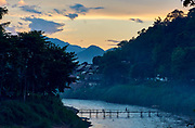 Laos. Luang Prabang. Bamboo bridge across Nam Khan river at sunset.