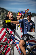 Kate Courtney (USA) is congratulated by family after winning the Women Elite Cross Country event at the 2018 UCI MTB World Championships - Lenzerheide, Switzerland