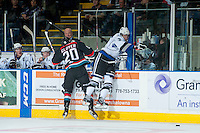 KELOWNA, CANADA - SEPTEMBER 28: Ryan Gagnon #3 of the Victoria Royals misses a check on Austin Glover #20 of the Kelowna Rockets at the Kelowna Rockets on September 28, 2013 at Prospera Place in Kelowna, British Columbia, Canada (Photo by Marissa Baecker/Shoot the Breeze) *** Local Caption ***