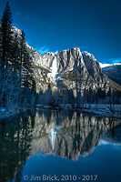 From Swinging Bridge, an early morning reflection of Yosemite Fall in the Merced River.