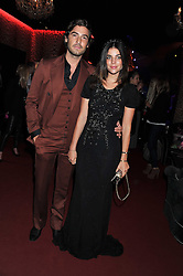 JULIA RESTOIN ROITFELD and ROBERT KONJIC at a party hosted by Roberto Cavalli to celebrate his new Boutique's opening at 22 Sloane Street, London followed by a party at Battersea Power Station, London SW8 on 17th September 2011.