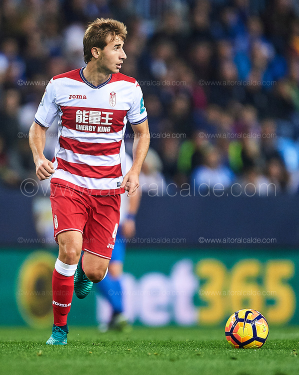 MALAGA, SPAIN - DECEMBER 09:  Sergi Samper of Granada CF in action during La Liga match between Malaga CF and Granada CF at La Rosaleda Stadium December 9, 2016 in Malaga, Spain.  (Photo by Aitor Alcalde Colomer/Getty Images)