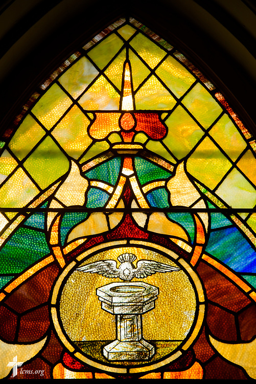 Stained glass depicting the Holy Spirit and baptism at Zion Lutheran Church on Thursday, July 13, 2017, in Ottawa, Ill.  LCMS Communications/Erik M. Lunsford