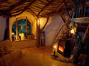 A house fit for a Hobbit: The homeowners that have brought the silver screen to life<br /> <br /> They are perhaps a sign that the owners have taken their obsession with the silver screen a bit too far. <br /> But these homes from around the world built on movie themes are nonetheless stunning pieces of 'surreal estate'. <br /> They include a tiny cottage based on the JRR Tolkien novel The Hobbit, the prequel to the Lord of the Rings saga and a Flintstones home apparently carved inside a boulder.<br /> <br /> Simon Dale designed the Middle Earth inspired dwelling, which is actually in Wales, as he sought to create an affordable house that blends into the hillside.<br /> As well as its movie appeal, the house, which is made from an oak frame and has a roof comprising mud and turf, has green credentials too.<br /> Underground air cools the refrigerator, solar panels power the appliances and a nearby spring provides water for the house.<br /> <br /> Photo Shows: Tucked into a hillside, the home uses oak framing, which bolsters a roof composed of mud and turf.<br /> ©Simon Dale/Exclusivepix