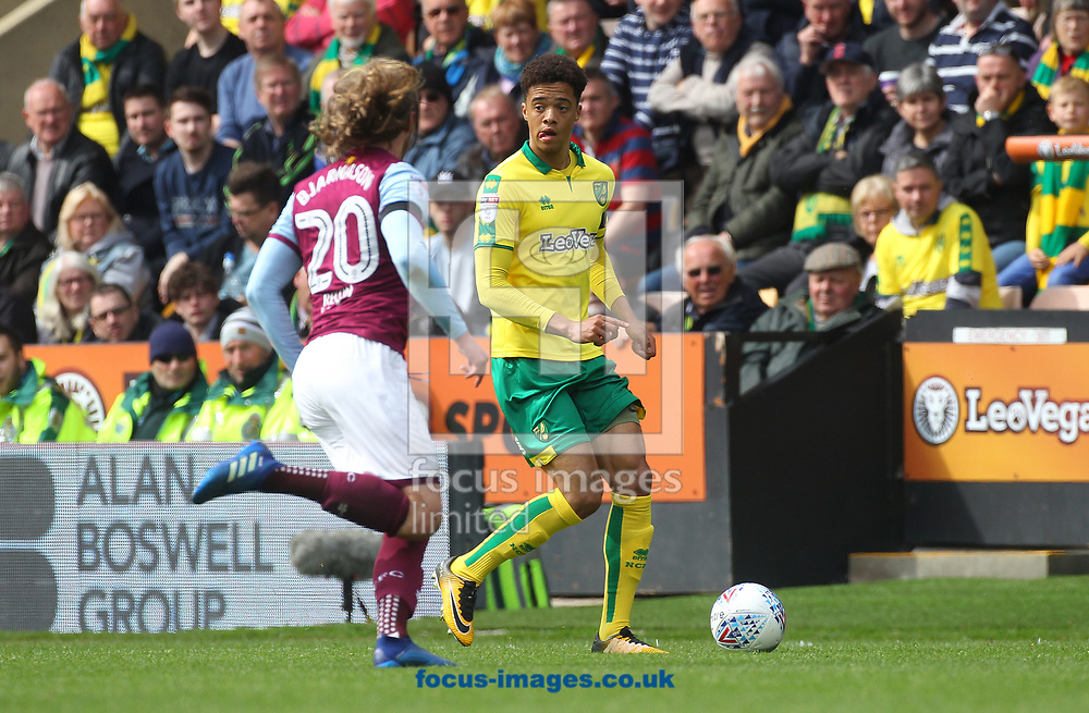 Birkir Bjarnason of Aston Villa and Jamal Lewis of Norwich in action during the Sky Bet Championship match at Carrow Road, Norwich<br /> Picture by Paul Chesterton/Focus Images Ltd +44 7904 640267<br /> 07/04/2018