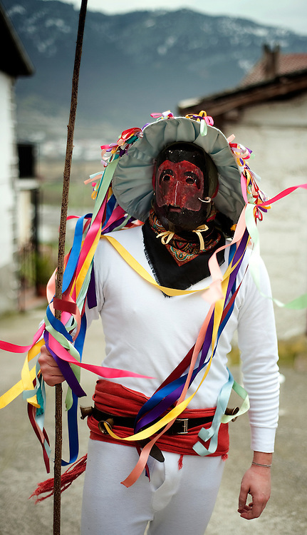 A momotxorro poses with his mask and stick, during the ancient carnival of Unanu, North of Navarra province in Spain, on March 8, 2011. Momotxorros chase locals and slash them with sticks.   PHOTO/ RAFA RIVAS