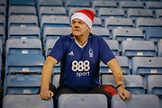 Nottingham Forest football fan, football supporter, during the EFL Sky Bet Championship match between Millwall and Nottingham Forest at The Den, London, England on 6 December 2019.