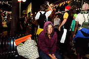 TAMPA, FL - August 27, 2012 - A homeless women looks at me as the Roving Radical Dance Party moves past her.