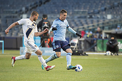 March 11, 2018 - Bronx, New York, United States - New York City FC defender BEN SWEAT (2) fights for the ball chased by Los Angeles Galaxy defender PERRY KITCHEN (2) during a regular season match at Yankee Stadium in Bronx, NY.  NYCFC defeats LA Galaxy 2 to 1. (Credit Image: © Mark Smith via ZUMA Wire)