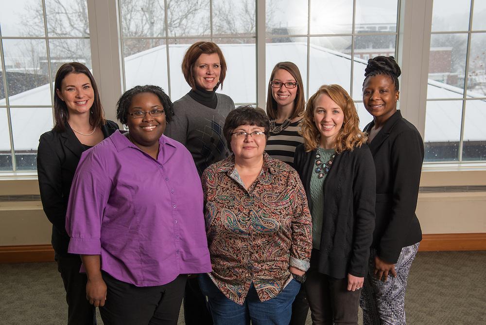 Student Success Advisors (Front Row , Left to Right)  Joy Cobb, Lourdes Giodani, Julie Chiki, (Back Row, Left to Right) Paula Linscott, Traci O. Connor, Katie Thomson, Ebony Porter. Photo by Ben Siegel