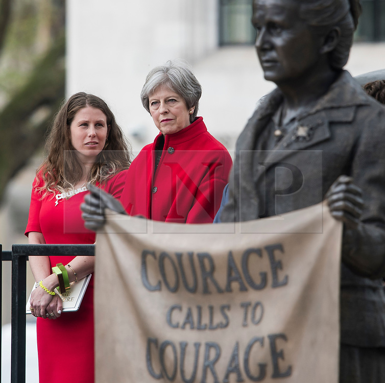© Licensed to London News Pictures. 24/04/2018. London, UK. Campaigner Caroline Criado-Perez and British Prime Minister Theresa May attend the unveiling of a statue of Millicent Fawcett in Parliament Square, London. Dame Millicent, a leading Suffragist and campaigner for equal rights for women, is the first woman to be commemorated with a statue in Parliament Square. Photo credit: Ben Cawthra/LNP