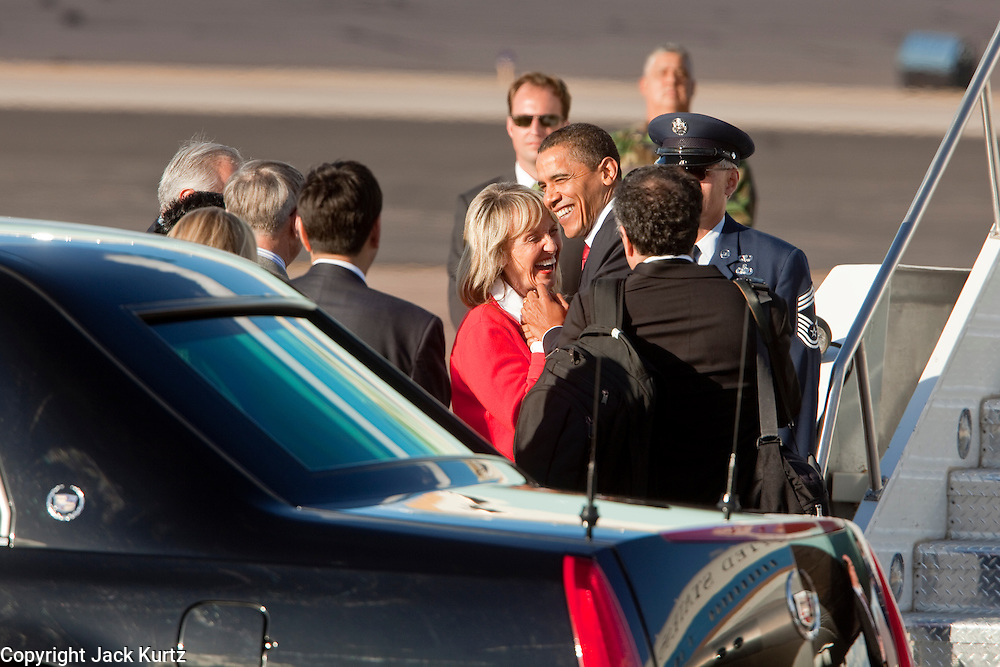17 FEBRUARY 2009 -- President Barack Obama greets Gov. Jan Brewer during the arrival of President Barack Obama at Sky Harbor Airport Tuesday.   PHOTO BY JACK KURTZ