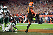 Cleveland Browns running back Carlos Hyde (34) high steps in celebration after running for a 1 yard touchdown that gives the Browns their 21-17 margin of victory late in the fourth quarter during the 2018 NFL regular season week 3 football game against the New York Jets on Thursday, Sept. 20, 2018 in Cleveland. The Browns won the game 21-17. (©Paul Anthony Spinelli)