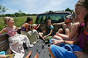 Curtis Millsap tells a story to the kids while riding back from the creek for a swim before lunch during farm camp on Wednesday, June 8, 2016.