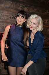 Left to right, ZARA MARTIN and PORTIA FREEMAN at the Lancôme pre BAFTA party held at The London Edition, 10 Berners Street, London on 14th February 2014.