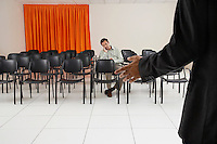Single man listening to a seminar in conference room