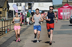 Joggers running at Leigh on Sea in Essex.