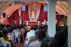 27 October 2019, Addis Ababa, Ethiopia: Rev. Abeya Sirika preaches during Sunday service at the Finfinne Oromo Mekane Yesus Congregation of the Ethiopian Evangelical Church Mekane Yesus. In a context where congregations did not use to be allowed to hold their services in any language but Amharic, the congregation today is one of some 60 Oromo speaking Mekane Yesus congregations in Addis Ababa. The service takes place on the first Sunday following political turmoil in the country, claiming dozens of lives.