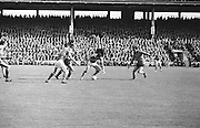 Kerry's L. Prendergast holds off Down defender as another Kerry player lifts the ball from the ground during the All Ireland Senior Gaelic Football Final Kerry v Down in Croke Park on the 22nd September 1968. Down 2-12 Kerry 1-13.