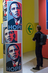 "© Licensed to London News Pictures. 27/03/2018. LONDON, UK. A visitor views ""Hope"" posters by Shepard Fairey, designed for Barack Obama's 2008 Presidential campaign. Preview of ""Hope to Nope: Graphics and Politics 2008-18"", an exhibition examining the political graphic design of a turbulent decade encompassing the 2008 financial crash, Barack Obam presidency, Brexit and Donald Trump's presidency.  The exhibition takes place at the Design Museum 28 March to 12 August 2018.  Photo credit: Stephen Chung/LNP"