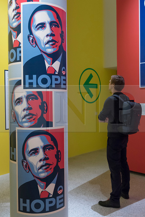 """© Licensed to London News Pictures. 27/03/2018. LONDON, UK. A visitor views """"Hope"""" posters by Shepard Fairey, designed for Barack Obama's 2008 Presidential campaign. Preview of """"Hope to Nope: Graphics and Politics 2008-18"""", an exhibition examining the political graphic design of a turbulent decade encompassing the 2008 financial crash, Barack Obam presidency, Brexit and Donald Trump's presidency.  The exhibition takes place at the Design Museum 28 March to 12 August 2018.  Photo credit: Stephen Chung/LNP"""