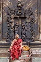 Buddhist monk  posing in the Shwe In Bin Monastery in Mandalay city Myanmar (Burma)