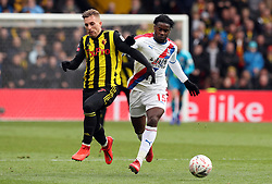 Watford's Gerard Deulofeu (left) and Crystal Palace's Jeffrey Schlupp battle for the ball during the FA Cup quarter final match at Vicarage Road, Watford.
