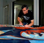 Los Angeles, California: artist Shepard Fairey signs lithographs of the Obama billboard he designed at his studio (Studio One) on Sunset Blvd. around the corner from Dodger Stadium in the Echo Park district of Los Angeles, 7/14/08. (Photo: Ann Summa).