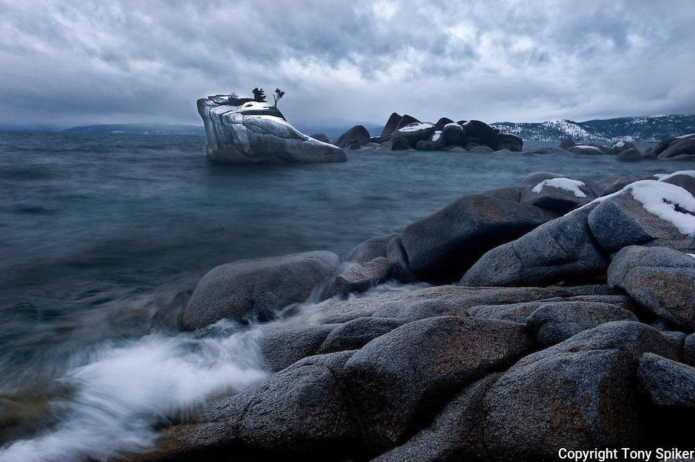 """Bonsai Rock Stormy Morning 2"" - A photograph of clouds rolling over Lake Tahoe at Bonsai Rock, on Lake Tahoe's Eastern shore"