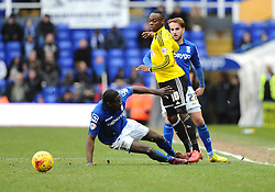 Brentford's Moses Odubajo is fouled by Birmingham City's Clayton Donaldson  - Photo mandatory by-line: Joe Meredith/JMP - Mobile: 07966 386802 - 28/02/2015 - SPORT - Football - Birmingham - ST Andrews Stadium - Birmingham City v Brentford - Sky Bet Championship