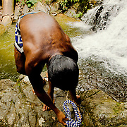 A young emberá Indian comes out of the water of the Dozake Villakirua waterfalls in the Chagres River.  The Emberás are one of the seven indigenous groups still present in Panama.  They are usually find by the Chagres River in the Panama Canal protected areas as well as in the mountains and rivers of the Darien jungle