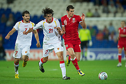 02.09.2011, Cardiff City Stadium, Cardiff, WAL, UEFA Euro 2012, Qualifier, Wales vs Montenegro, im Bild Wales' Gareth Bale in action against Montenegro's Stefan Savic during the UEFA Euro 2012 Qualifying Group G match at the  Cardiff City Stadium, EXPA Pictures © 2011, PhotoCredit: EXPA/ Propaganda/ D. Rawcliffe *** ATTENTION *** UK OUT!