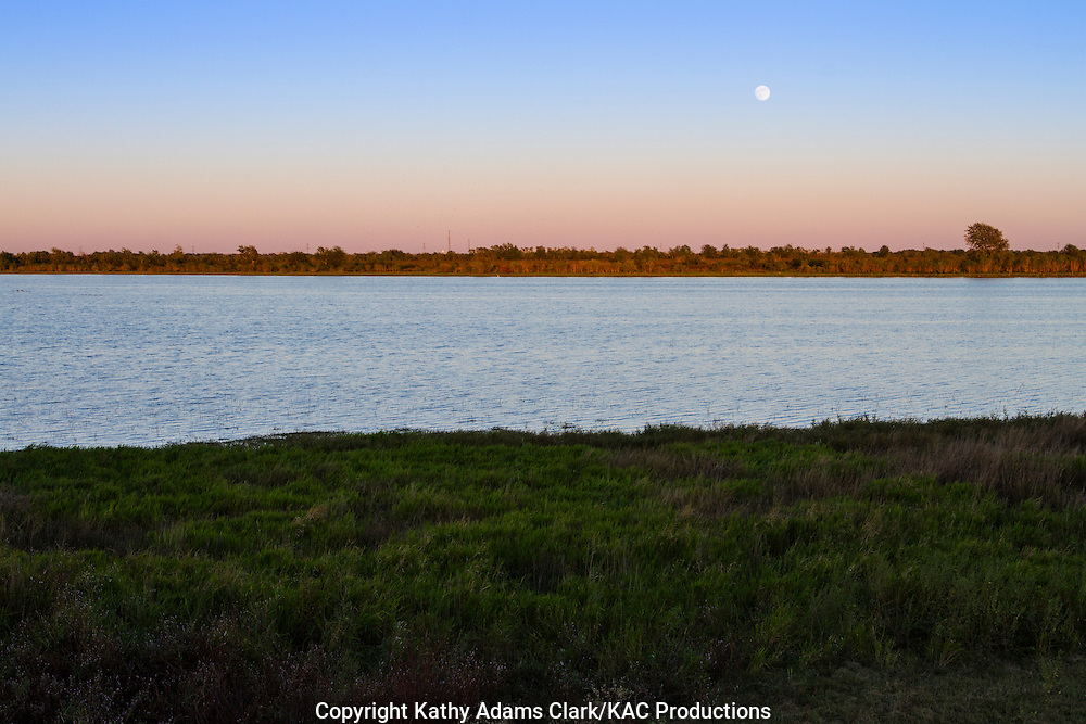 Harvest moon, full moon, rising, Warren Lake, Katy Prairie, west Harris County, coastal prairie, Texas.